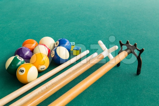 Closeup of snooker billards balls, chalk, cue and extender stick Stock Photo