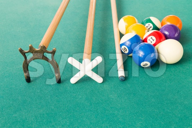 Closeup of snooker billards balls, cue and extender stick Stock Photo