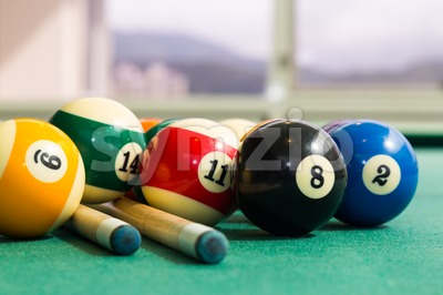 Closeup on snooker billards cue, chalk, balls on table Stock Photo