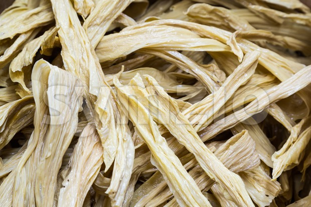 Stack of dried soya bean curd sheets for cooking Stock Photo