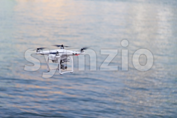Closeup on drone flying over river background Stock Photo