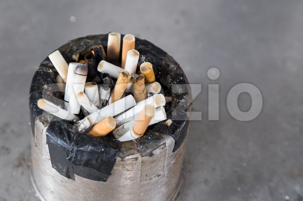 Dirty cigarette butts in ash tray Stock Photo