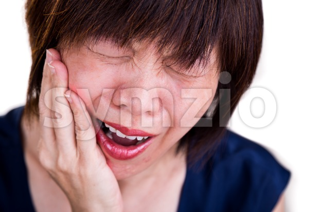 Closeup Asian woman with intense toothache pain Stock Photo