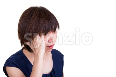 Asian women suffering from painful headache migraine Stock Photo