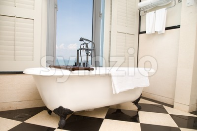 Luxury bathtub with relaxing ambient window  with scenic sea view Stock Photo