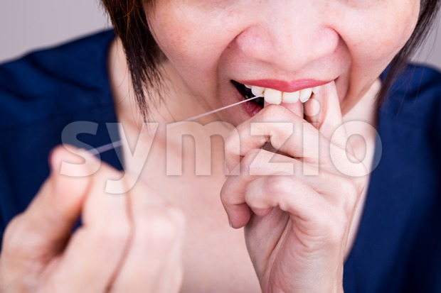 Series of closeup Asian woman flossing teeth with oral floss