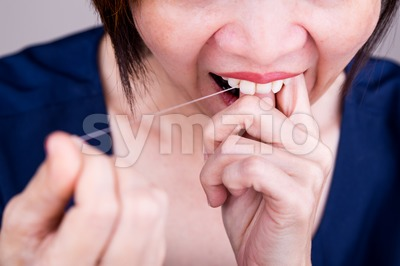 Series of Asian woman flossing teeth with oral floss Stock Photo