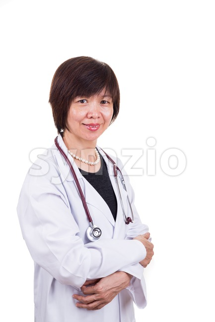 Asian female medical doctor with stethoscope on white background Stock Photo