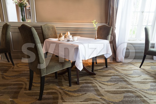 Elegant dining table with cutleries  set arranged for two person Stock Photo
