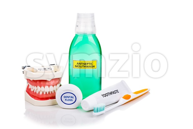 Oral care essentials soft tapered bristle toothbrush, toothpaste, mouthwash, dental floss recommended by dentist for oral health.