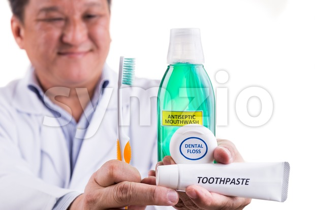 Dentist recommend tapered bristle toothbrush, toothpaste, mouthwash, and dental floss Stock Photo