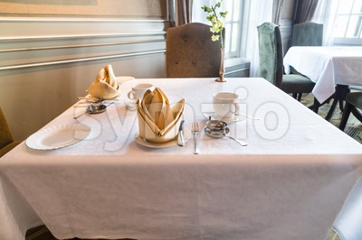 Perspective view of elegant dining table with cutleries for two Stock Photo