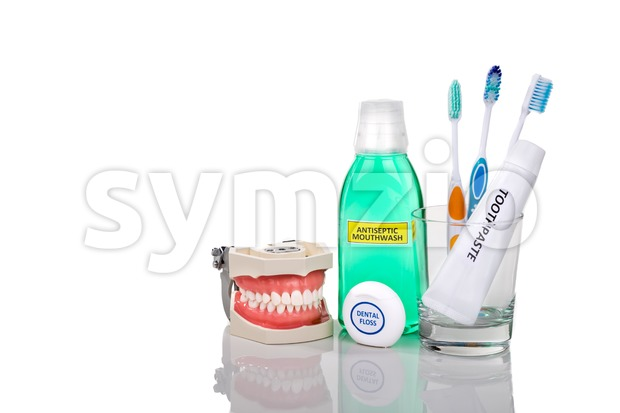 Oral care essential products tapered toothbrush, toothpaste, mouthwash, dental floss Stock Photo