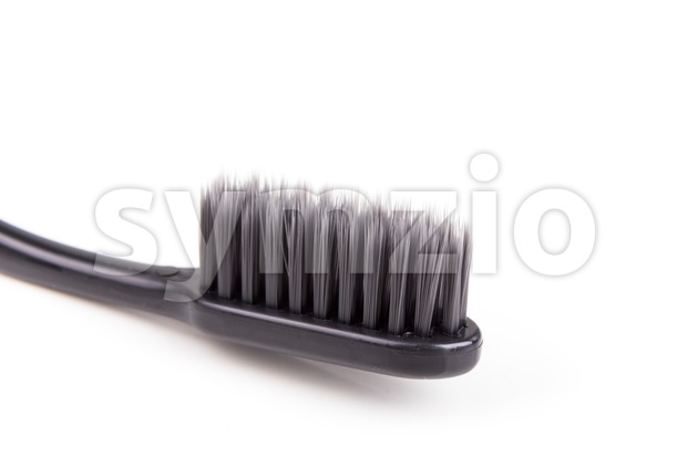 Closeup of toothbrush charcoal soft and slim tapered bristle Stock Photo