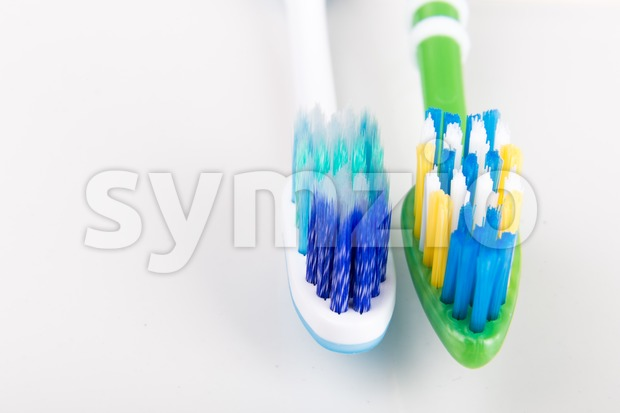 Comparison of toothbrush with  round tip bristle and tapered bristle Stock Photo