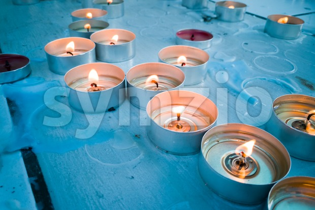 Candle tea lights on Church altar Stock Photo