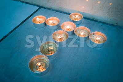 Candle tea lights in Christian crucifix cross formation Stock Photo
