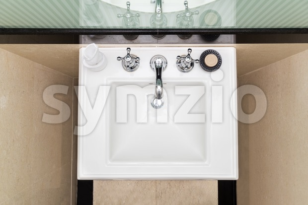 Contemporary and elegant wash basin sink in toilet Stock Photo