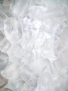 Ice cubes lighted from behind as background Stock Photo