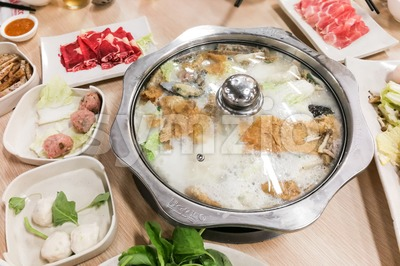 Traditional Chinese steamboat or hotpot with delicious food spread Stock Photo