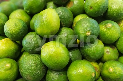 Heap of whole fresh organic lime Stock Photo