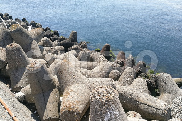 Concrete tetrapod at coast line to prevent erosion and protection Stock Photo