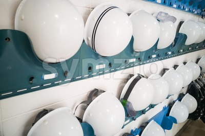 Industrial protection white safety helmet and goggles storage in factory Stock Photo