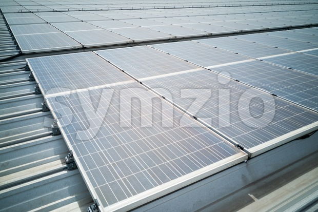 Closeup on solar panels on roof generate electricity Stock Photo