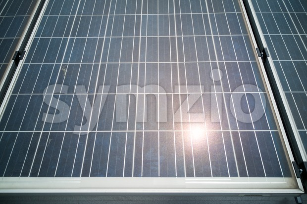 Closeup on solar panels with reflection of the sun Stock Photo