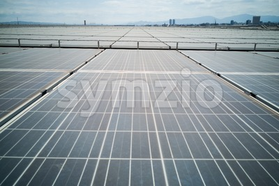 Solar panels on roof of industial building generate electricity Stock Photo