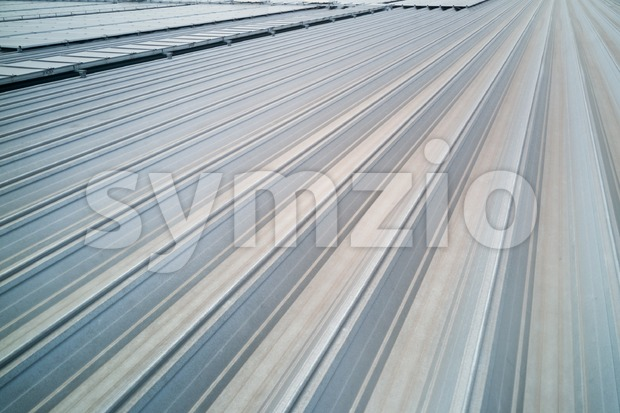 Aluminum industrial metal roof with interlocking grooves