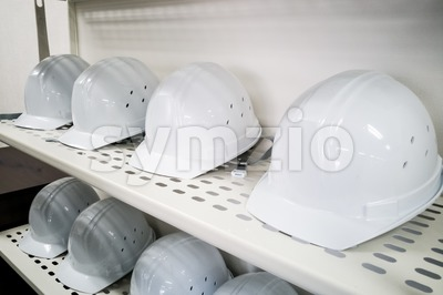 Industrial white safety helmet storage in factory Stock Photo