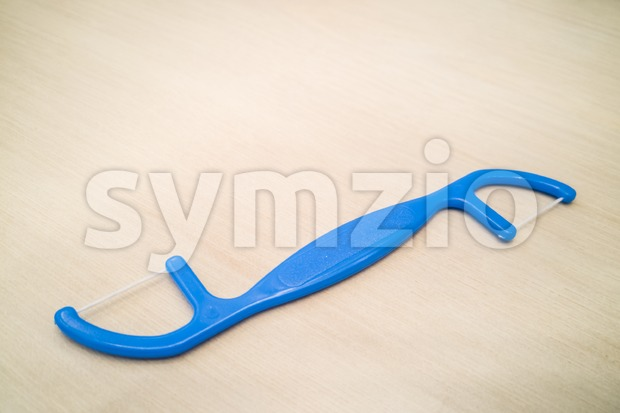 Closeup of floss stick for dental hygiene Stock Photo