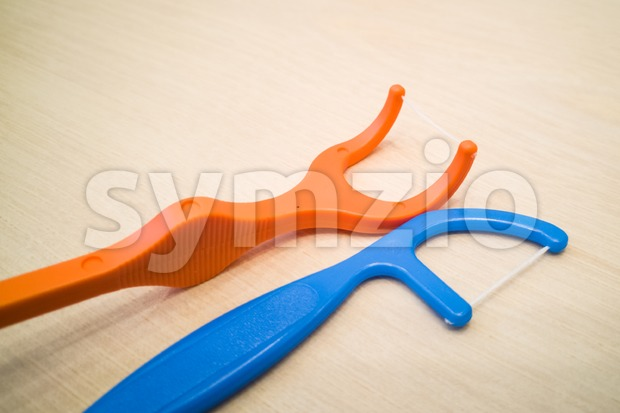 Closeup of floss stick for dental hygiene and oral-care