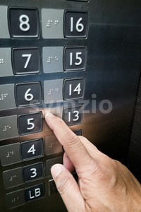 Closeup on finger reading Brialle on elevator panel Stock Photo