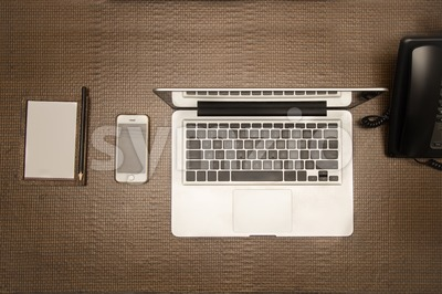 Essential gadgets phone, laptop and note pad for mobile office Stock Photo