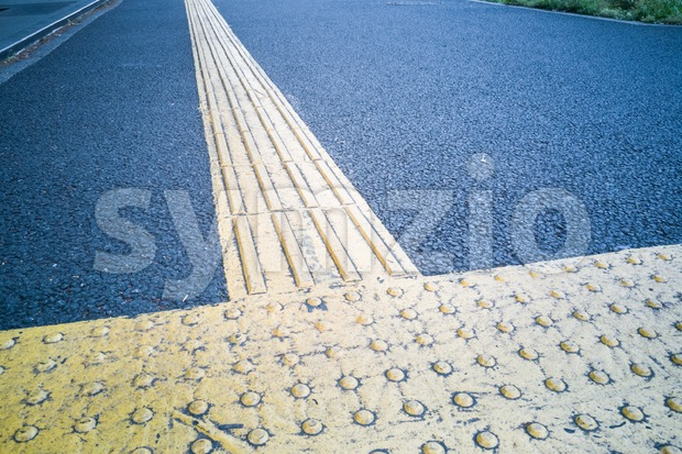 Outdoor pedestrian tactile facility for the blind or visually impaired people.