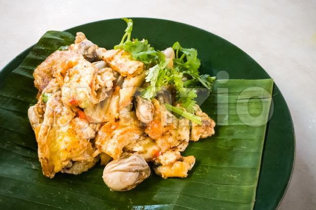 Asian delicious fried oysters with eggs omelette, popular cuisine food in Asia