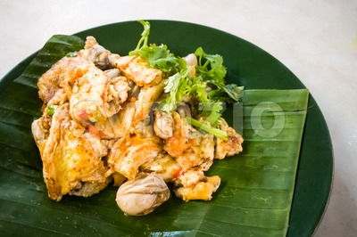 Asian delicious fried oysters with eggs omelette cuisine Stock Photo