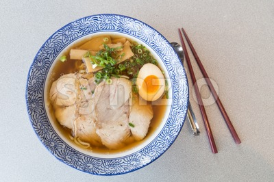 Delicious authentic Japanese Ramen with Pork and Egg in bowl Stock Photo
