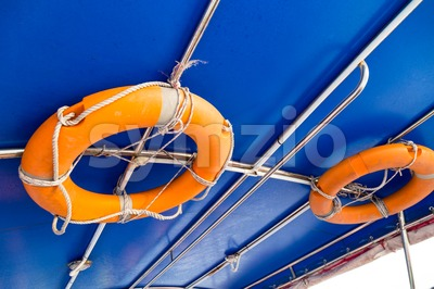 Life buoy attached to the ceiling of boat Stock Photo