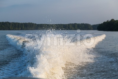 Wave generated by speed boat engine in ocean Stock Photo