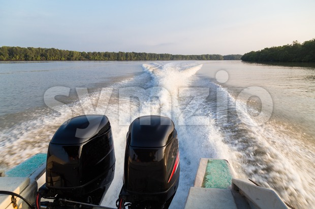 Wave generated by speed boat twin engine in river Stock Photo