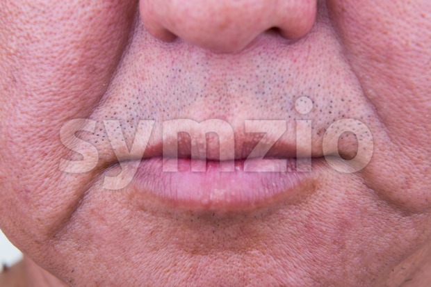 Closeup on saggy cheek skin of matured Asian man Stock Photo