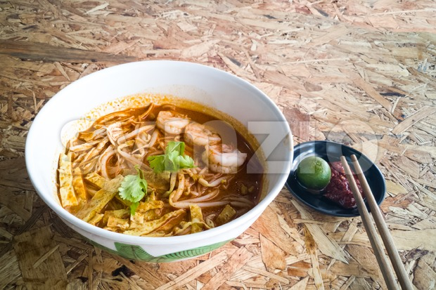 Authentic Sarawak laksa noodle with prawn and egg strips Stock Photo
