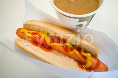 Simple hot dog sandwich with mustard ketchup and coffee Stock Photo