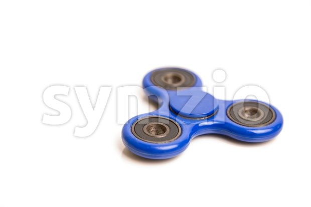 Blue fidget spinner in white background Stock Photo