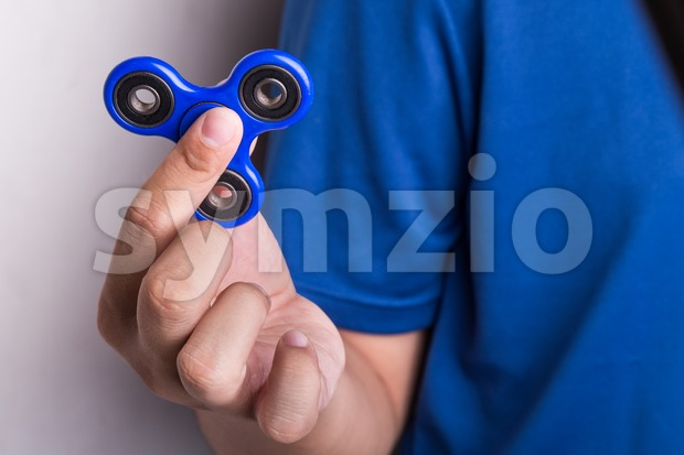 Teenager holding the fidget spinner Stock Photo