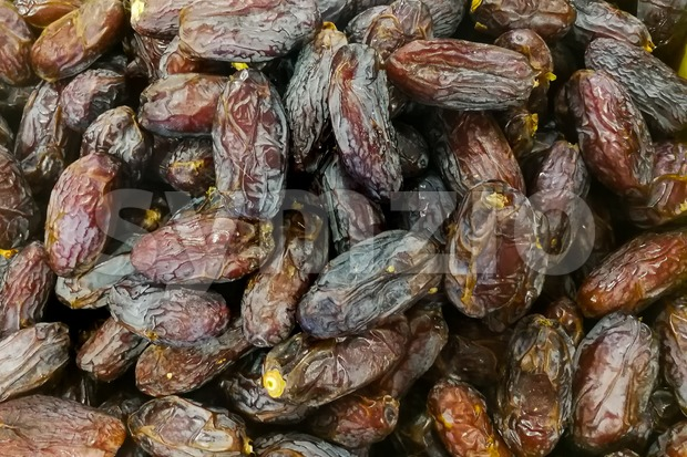 Close-up on sweet dried dates on sale at bazaar stall for Muslim iftar break fast