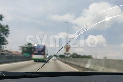 Perspective view of cracked car windscreen or windshield while driving Stock Photo